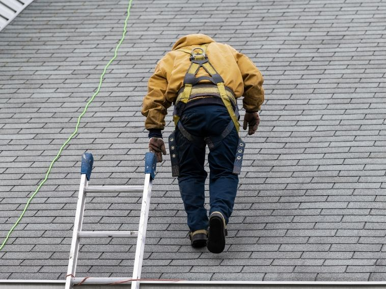 Benefits of a Professional Roof Inspection After a Storm style=